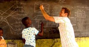 volunteer teacher at blackboard teaching