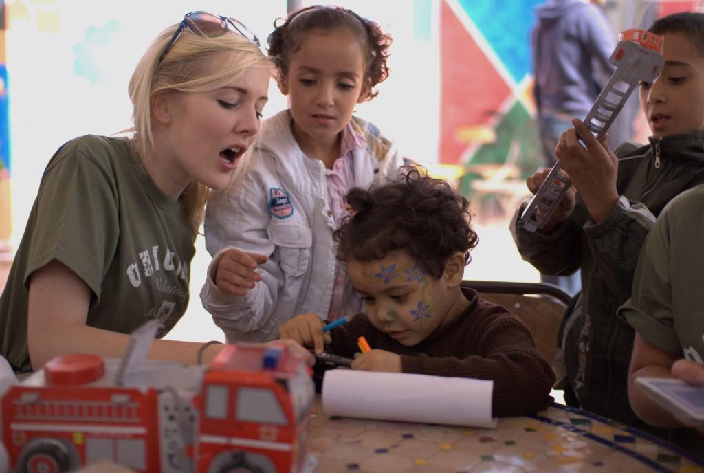 volunteer-with-small-children-1024x688