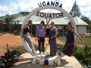 volunteers-stand-on-equator-line-in-uganda